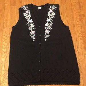 Two twenty knitted cotton vest